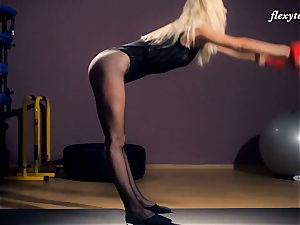 Fit Elena demonstrates off her gymnast nude assets