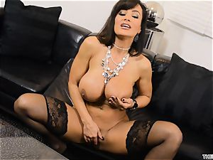 Lisa Ann pushes her fake penis deep in her humid cootchie