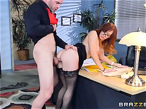 Dani Jensen frolicking with pink cigar in the office