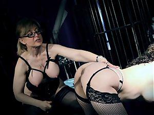 dominatrix Nina Hartley torments Kiki Daire's raw clitoris